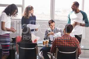 Business colleagues discussing at desk