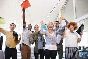 Cheerful business people with arms raised in office