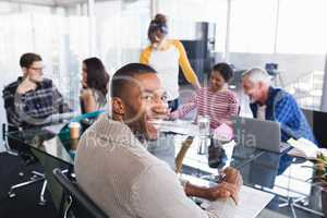 Smiling businessman sitting in meeting
