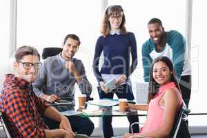 Portrait of confident business people at desk