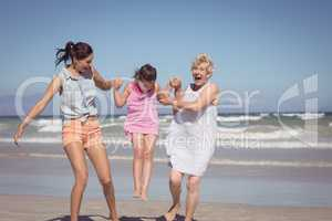 Cheerful multi-generation family playing at beach