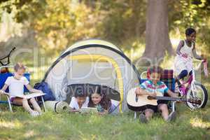 Children enjoying at campsite