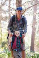 Portrait of playful father and son in forest