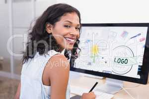 Smiling businesswoman using desktop computer