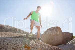 Man ready to jump from rock