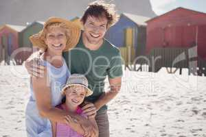 Portrait of multi-generation family embracing at beach