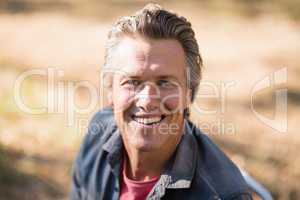 Portrait of smiling man on sunny day