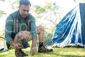 Man setting up the tent