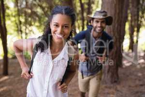 Portrait of happy couple hiking in forest