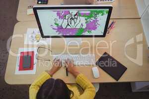 Female graphic designer working in creative office