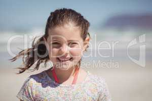 Portrait of smiling girl at beach