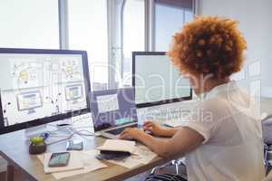 Focused businesswoman working on laptop