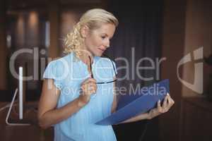 Attentive executive reading file