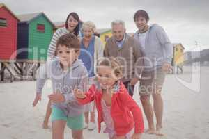 Happy multi-generation family at beach