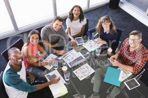 High angle portrait of business people sitting at desk