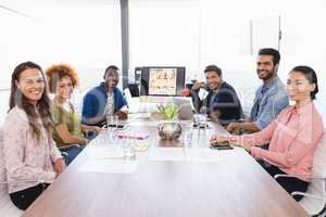 Portrait of business people sitting at desk