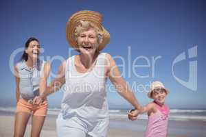 Cheerful multi-generation family at beach