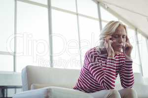 Tensed entrepreneur sitting on sofa