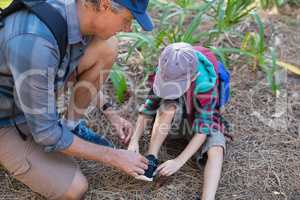 High angle view of man tying shoelace of son