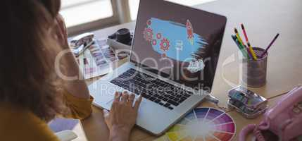 graphic designer working on laptop in office