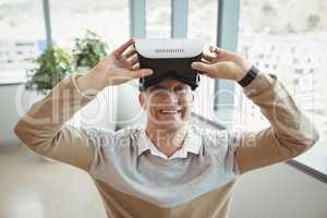 Portrait of happy executive using virtual reality headset