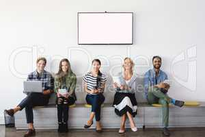 Portrait of smiling business people sitting on seat