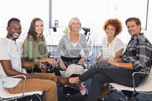 Portrait of smiling business people sitting on chairs