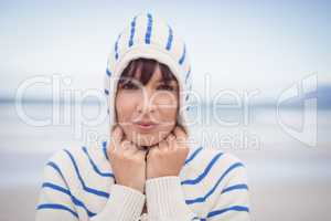 Portrait of woman wearing hooded sweater during winter