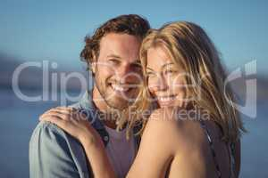 Thoughtful couple hugging at beach