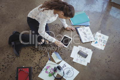 Graphic designer with digital table working on floor