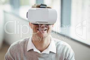 Happy executive using virtual reality headset