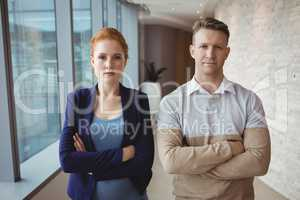 Portrait of executives standing with arms crossed