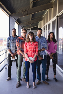 Full length portrait of business people in balcony