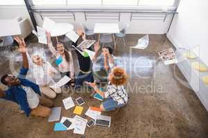Cheerful business team tossing papers at office