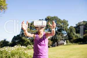 Girl using vr headset in the park