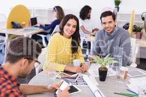 Portrait of business people at desk