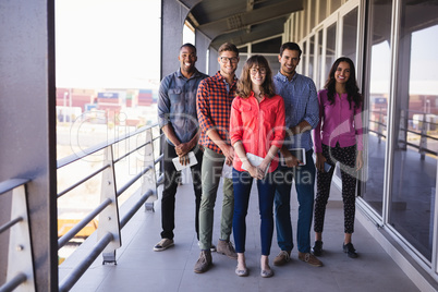 Full length portrait of smiling business people in balcony