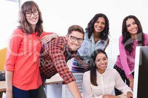 Portrait of business people working over desktop computer