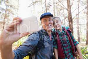 Happy father and son taking selfie from mobile phone