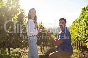 Portrait of young man proposing girlfriend at vineyard