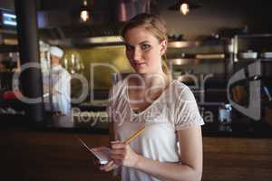 Waitress taking order at restaurant