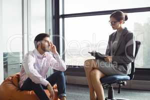 Unhappy man talking to counselor