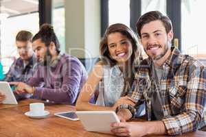 Friends using digital tablets in restaurants