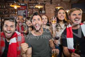 Cheerful friends enjoying in pub