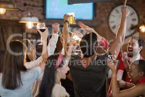 Friends enjoying in pub