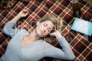 Woman sleeping on blanket