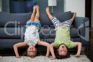 Siblings having fun in living room