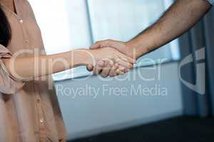 Cropped image of business people shaking hands during meeting