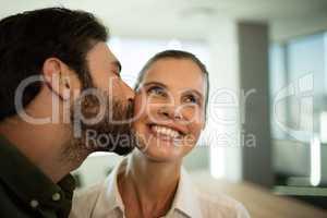 Close up of businessman kissing businesswoman