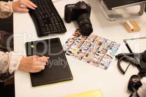 Cropped image of designer working on digitizer